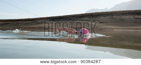 Female Swimmer In A Dam