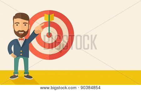 A Caucasian salesman happy standing while his hand pointing to the arrow from target pad shows that he hit his target sales. Business concept. A Contemporary style with pastel palette, soft beige