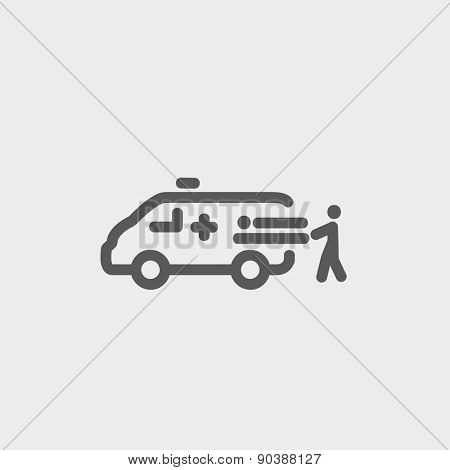 Man and ambulance car icon thin line for web and mobile, modern minimalistic flat design. Vector dark grey icon on light grey background.