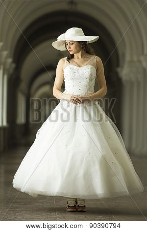 Young Woman In White Long Dress And Hat In Sneakers.
