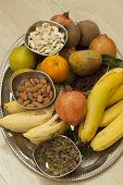 Top View of Fruits and dry fruits from thread ceremony function, India poster