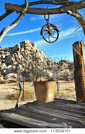 JOSHUA TREE, CALIFORNIA - JANUARY 1, 2016: Boarded up well at Keys Ranch. Rustic abandoned well in Joshua Tree National Park.