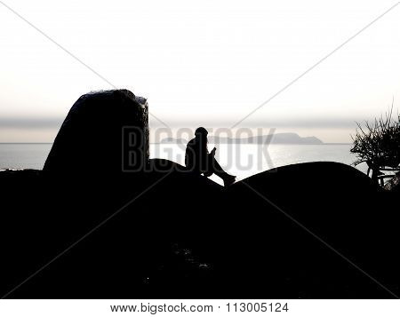 A woman watching the sunset in Miraflores, Lima, Peru