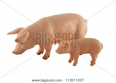 Toy pig and piglet isolated on white