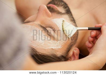 Cheerful guy is attending beauty salon