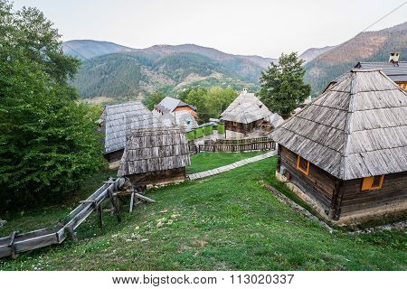 Wooden cottage houses in traditional Drvengrad village Serbia poster