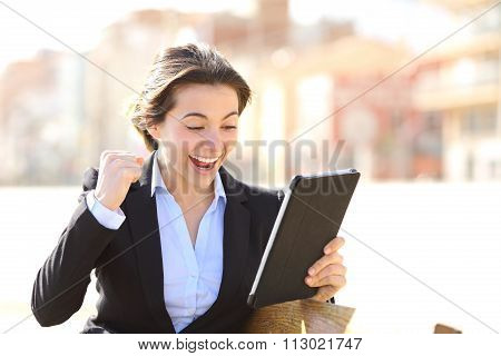 Euphoric Successful Executive Watching A Tablet