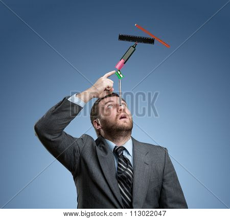 Businessman with stationery holding on his nose