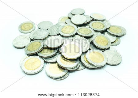 Group Of Thai Baht Coins On White Table Background