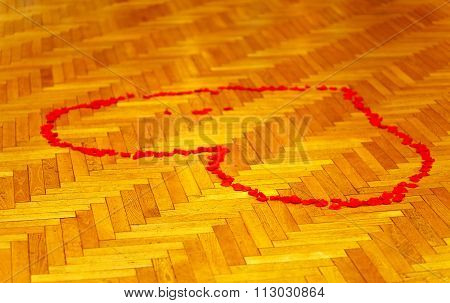 red heart of rose petals on dance parket - love concept.
