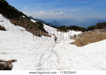 Mountaineer descending alone on mountain snowfield, Austria Alps