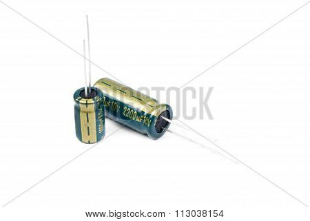 Two Electrolytic Capacitor In Green Isolated On White