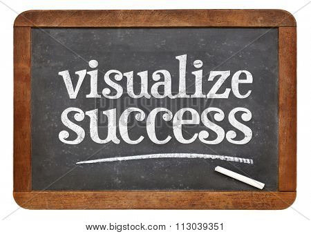 visualize success advice - white chalk text  on a vintage slate blackboard