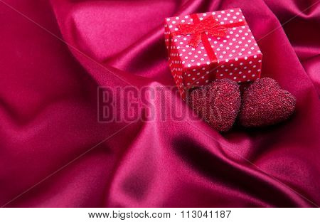Red Silk Fabric Background And Gift Box
