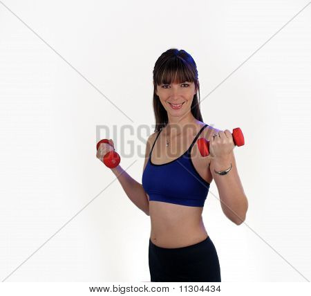 A lovely young brunette wearing fitness wardrobe holds a pair of hand weights. poster