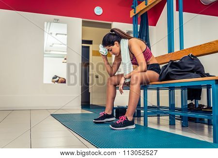 Tired Woman After A Workout In The Gym Locker Room