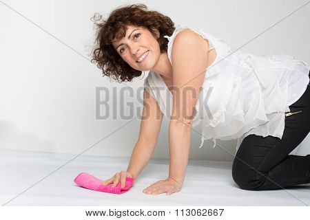 Smiling  Woman Cleaning Floor With Cleaning Supplies Isolated