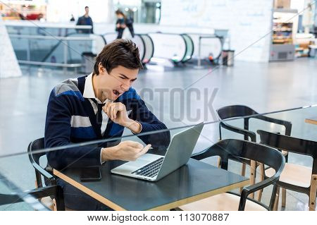 Angry freelancer upset and hate his laptop