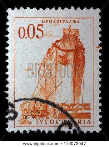 YUGOSLAVIA - CIRCA 1966: stamp printed by Yugoslavia, shows a ship in a shipyard, series, circa 1966