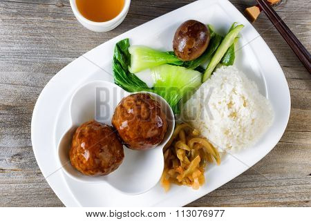 Saucy Meatball Dish In White Plate Ready To Eat