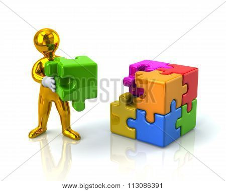 Golden Man And Colorful 3D Puzzle Cube With A Missing Piece