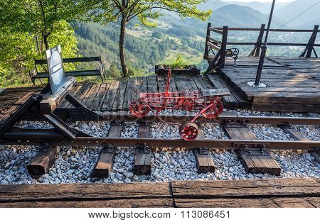 Trolley next to Sargan Eight narrow gauge railway from the village of Mokra Gora to Sargan Vitasi station in Serbia poster