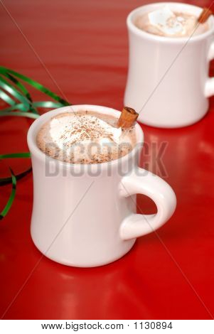 Two Cups Of Hot Chocolate With Green Ribbon