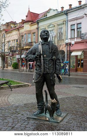 Mukachevo, Ukraine - April 6, 2015: Monument of Happy Chimney Sweeper and his cat. The monument with real chimney sweeper Bertalon Tovt by Ukrainian sculptor Ivan Brovdi
