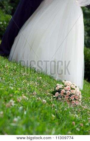 Bridal Bouquet Lies On The Grass