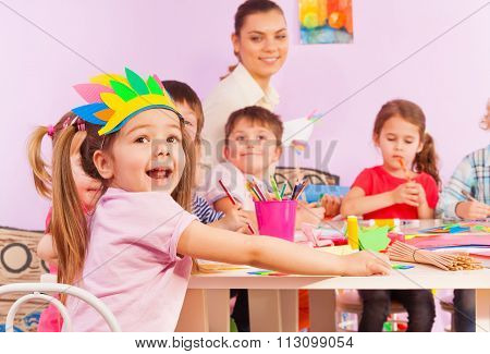 Portrait of happy girl in early developing class
