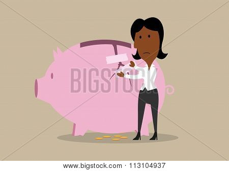 Businesswoman repairing broken piggy bank