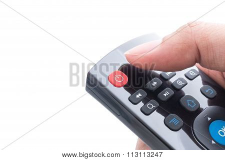 Finger Will Push Power Button On Remote Control Over White Background
