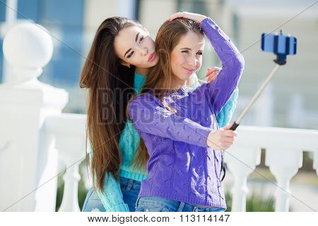 Young beautiful girlfriends the students doing the selfie