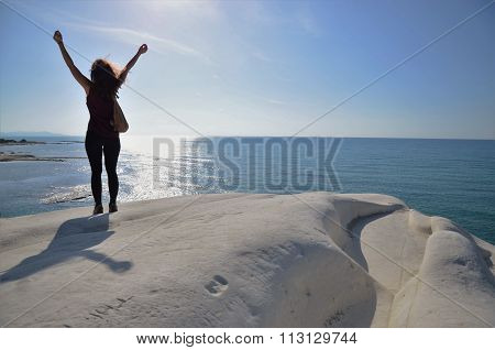 Woman standing on white cliffs in Sicily