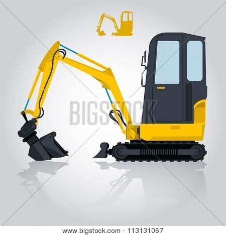 Yellow small digger builds