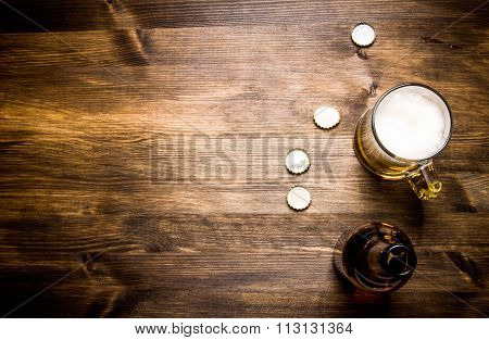 Beer Style - Bottle, Beer In The Glass And Covers On Wooden Table. Free Space For Text.