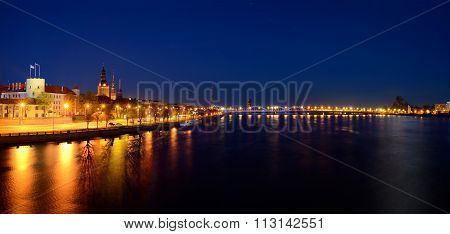general view on Riga embankment and its illumination during nightfall Latvia poster