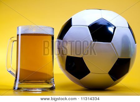 Glass of beer& football