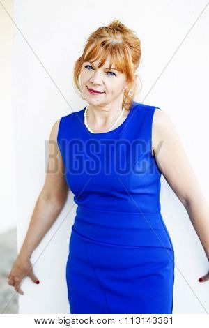Portrait of adult woman in blue dress