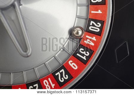 Casino Roulette Detail With Ball In Number Fourteen. Gambling