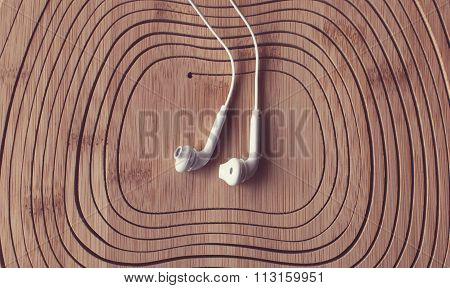 beautiful earplugs on wood surface with color filters