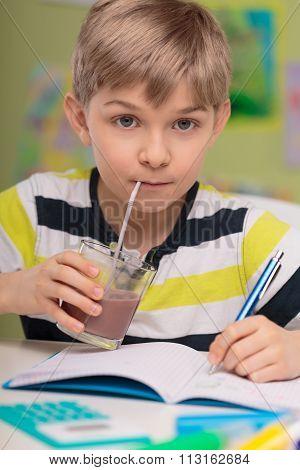 Child Drinking Caloric Cocoa