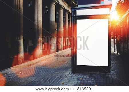Advertising mock up outdoors, clear poster in urban setting,empty public information board on street