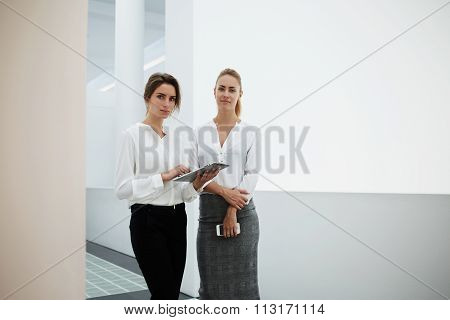 Conference female using digital tablet for discuss work issues with partner