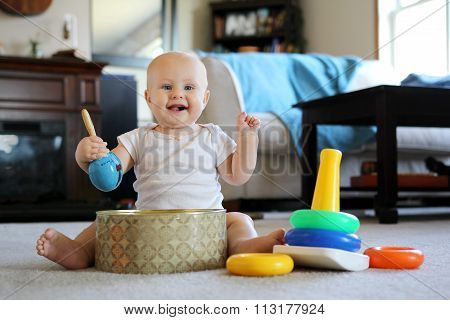 Happy Baby Playing With Music Toys At Home