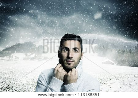 Atractive Man Warm Up With Pullover And Looking Sideways To Fallen Snowflakes In Front Of Winter Lan