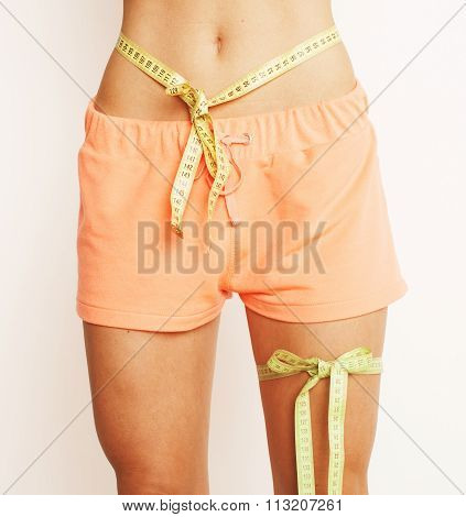 woman measuring waist with tape on knot like a gift, tann isolated close up white background good fe