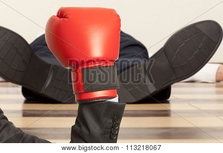 Business knockout. Businessman in red boxing gloves