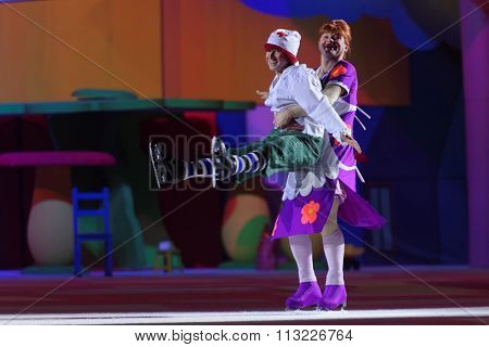ST. PETERSBURG, RUSSIA - DECEMBER 29, 2015: Figure skaters Alexey Yagudin as Karlsson and Alexey Tikhonov as Froken Bock in a scene of New Year show of Ilya Averbukh in the Sports center Yubileyniy