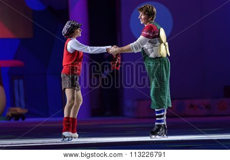 ST. PETERSBURG, RUSSIA - DECEMBER 29, 2015: Figure skaters Maria Petrova as Lillebror and Alexey Yagudin as Karlsson-on-the-Roof in a scene of the New Year show of Ilya Averbukh in the SC Yubileyniy